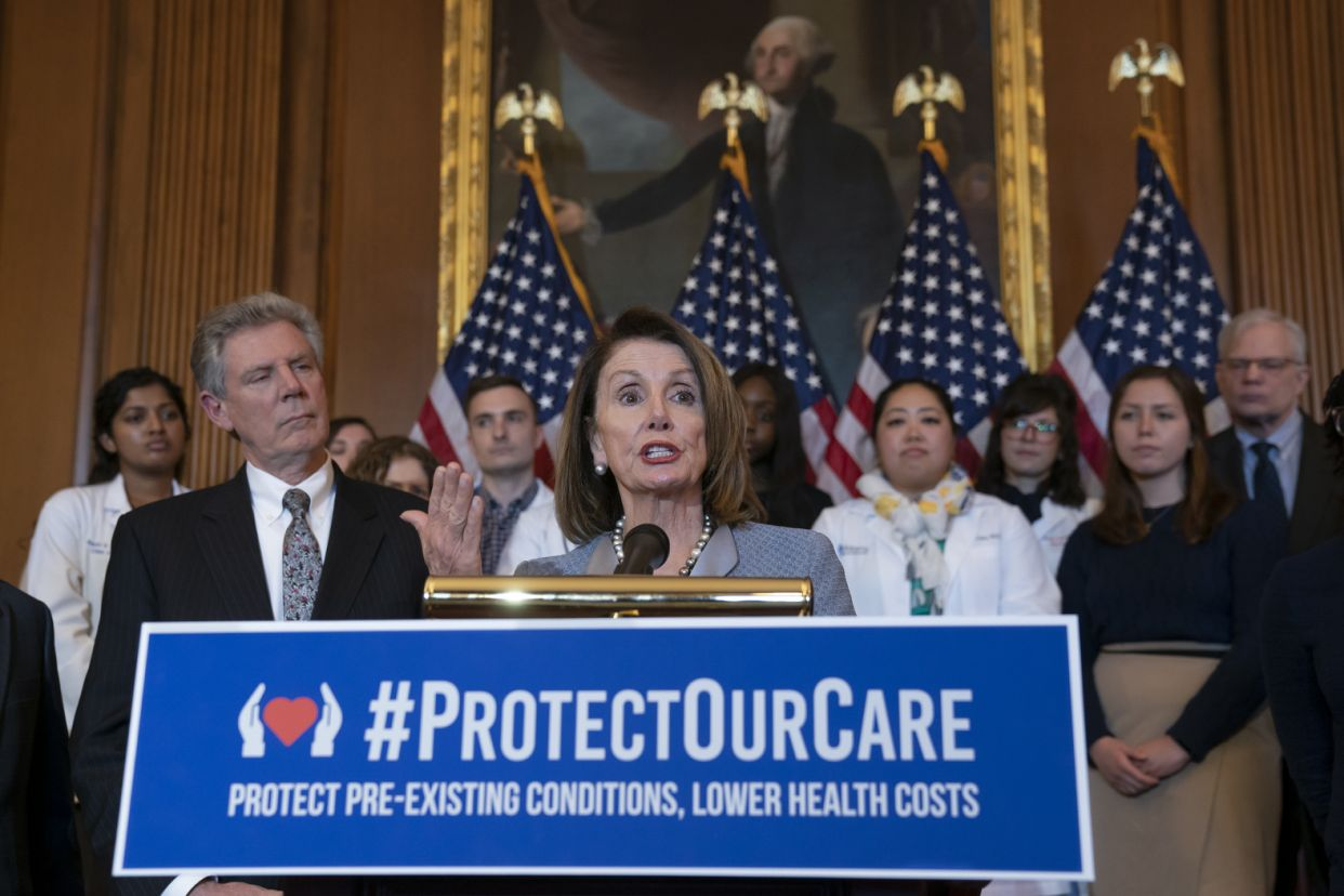 House Speaker Nancy Pelosi, joined at left by Energy and Commerce Committee Chair Frank Pallone, D-N.J. (Photo: J. Scott Applewhite/AP)
